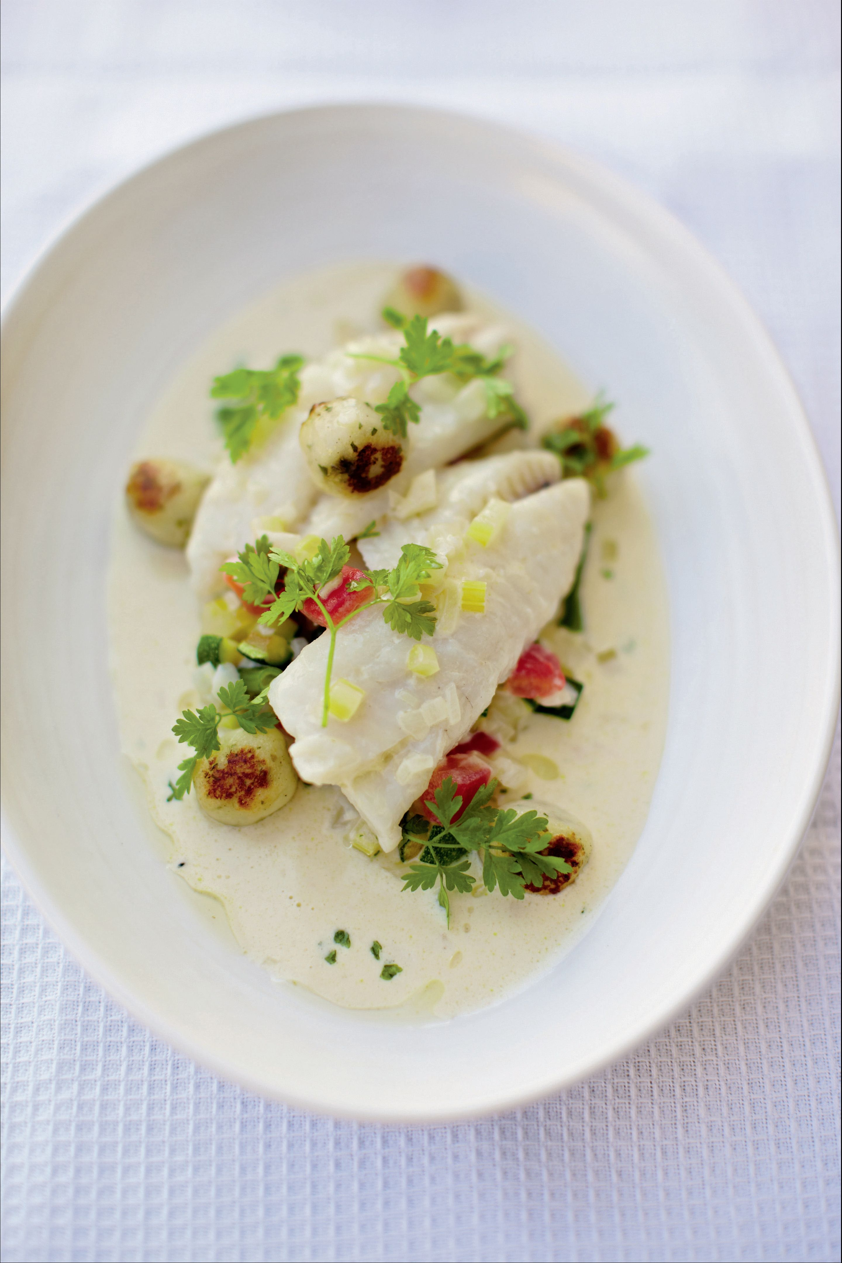 Poached whiting, summer vegetable broth and chervil dumplings