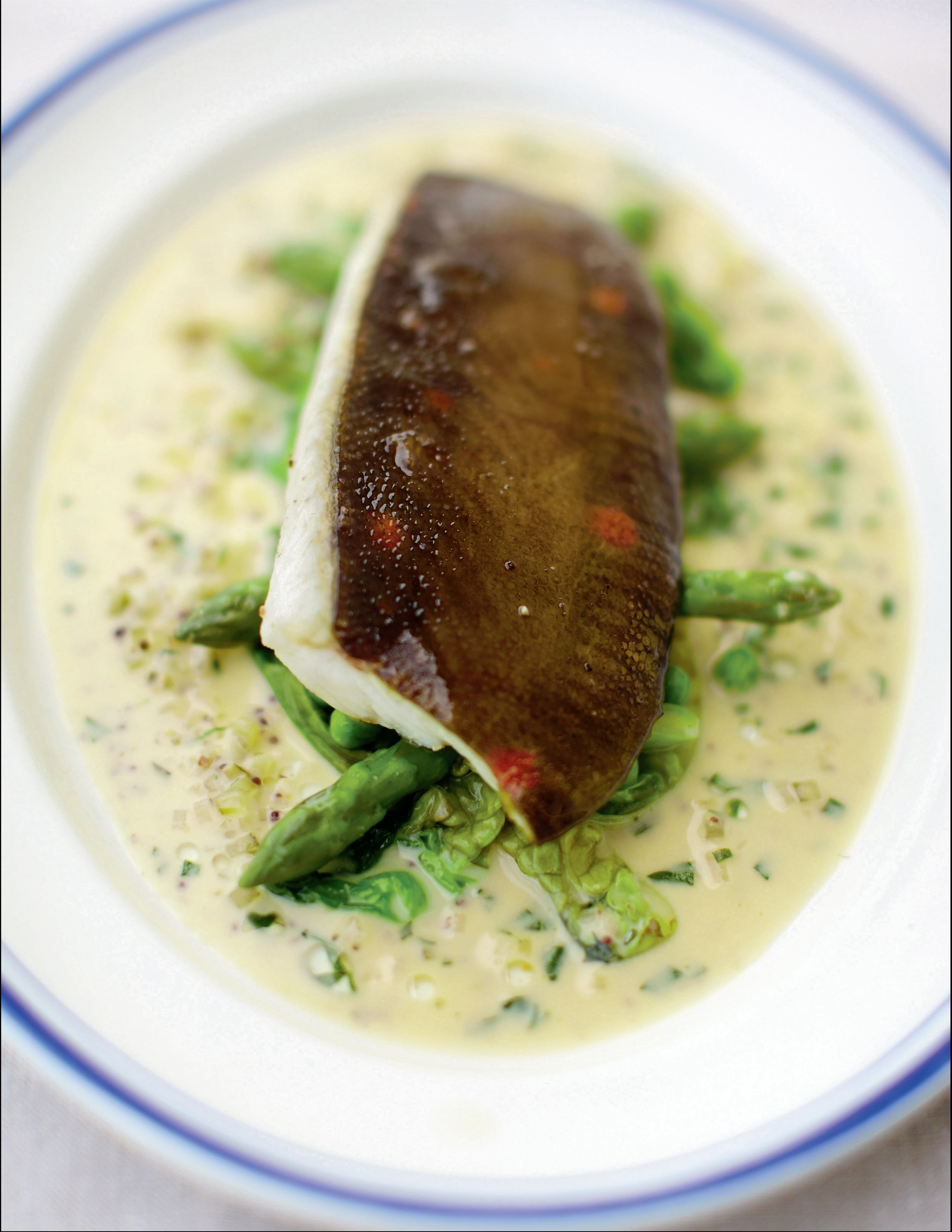 Grilled plaice with mustard and tarragon sauce, asparagus and peas