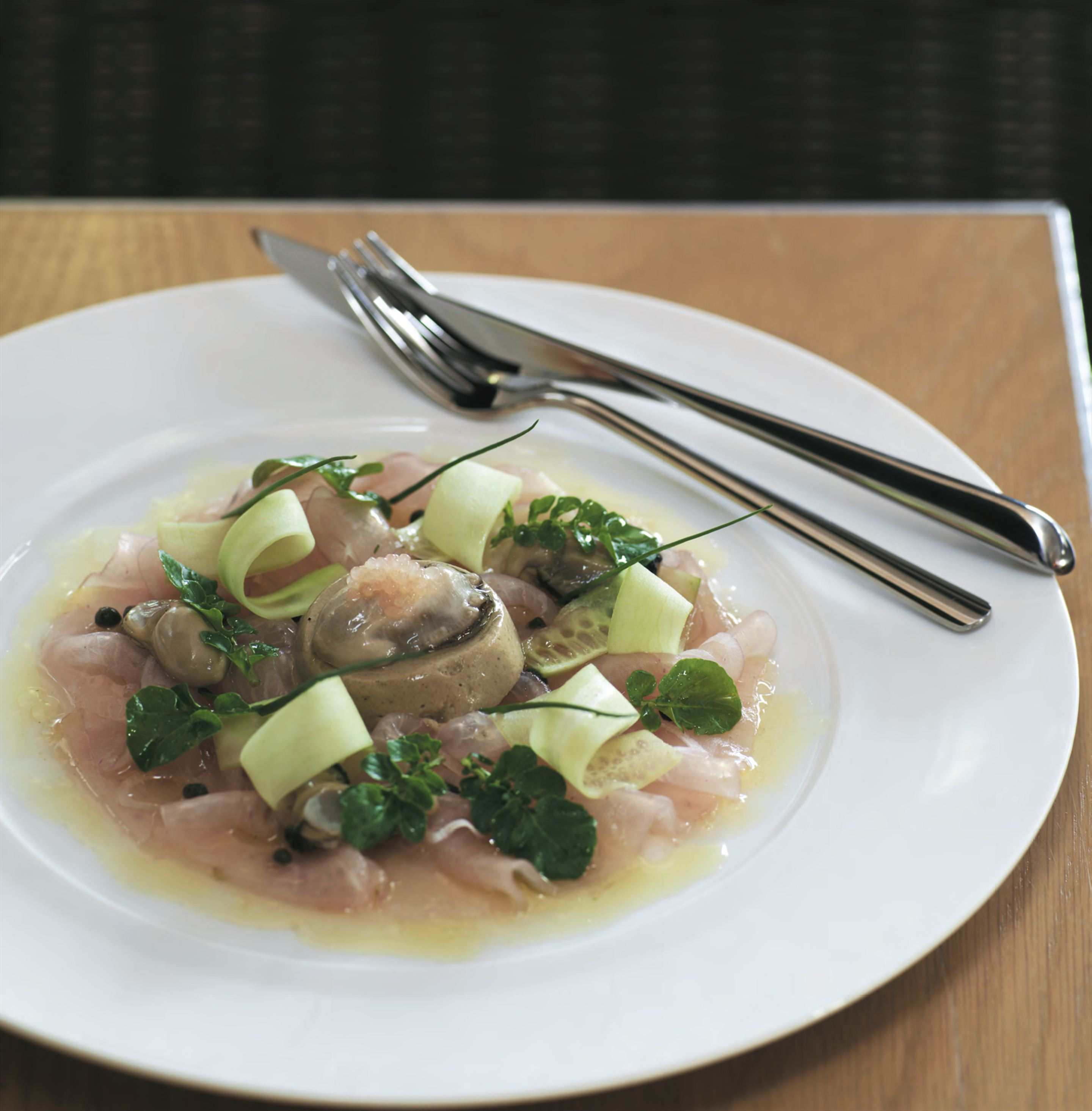 Carpaccio of hiramasa kingfish with rock and Pacific oysters