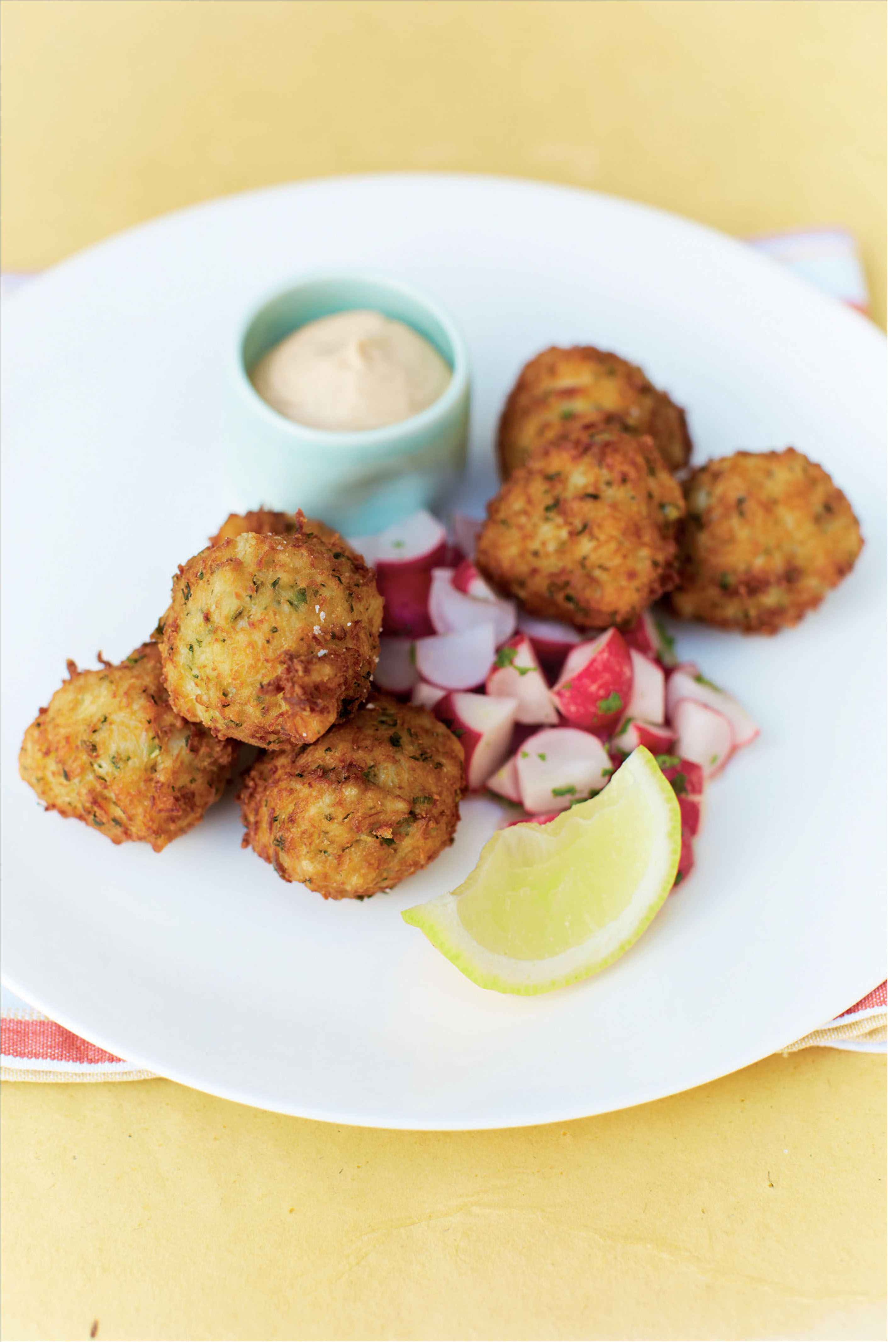 Crab cakes with crab custard and radish salad