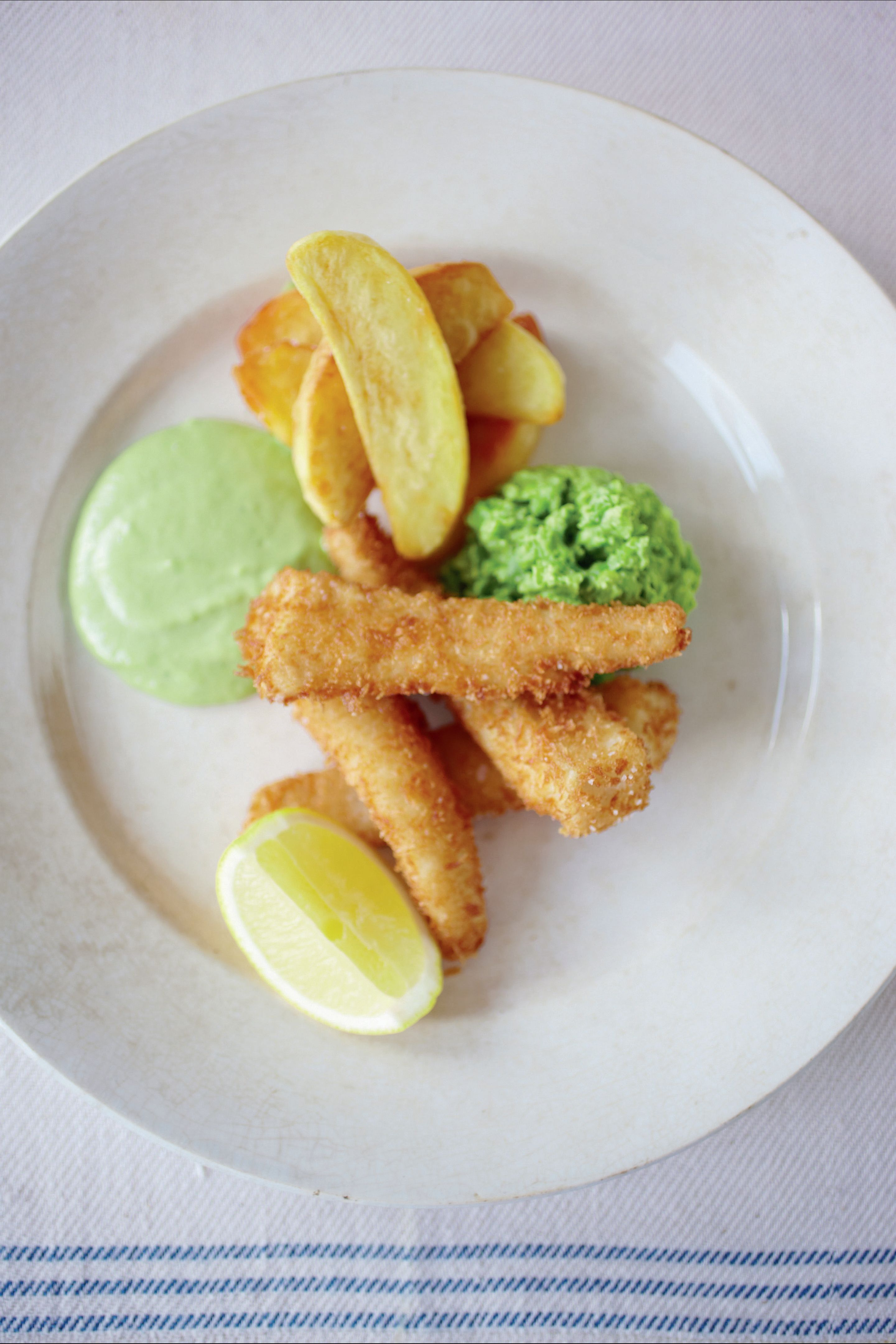 Hake fish fingers with Pete's chips, mushy peas and herb emulsion