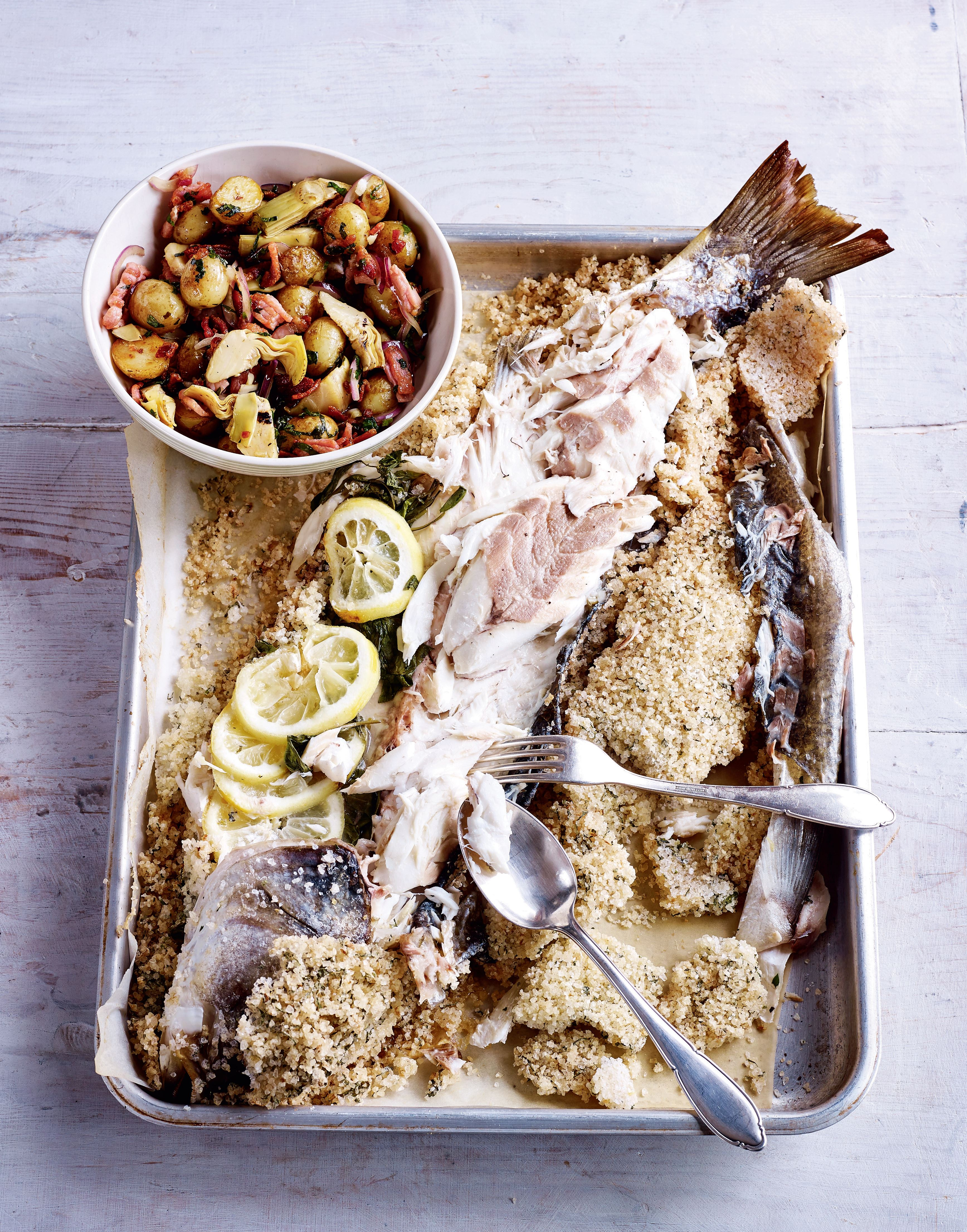 Salt baked sea bass with warm artichoke and bacon salad