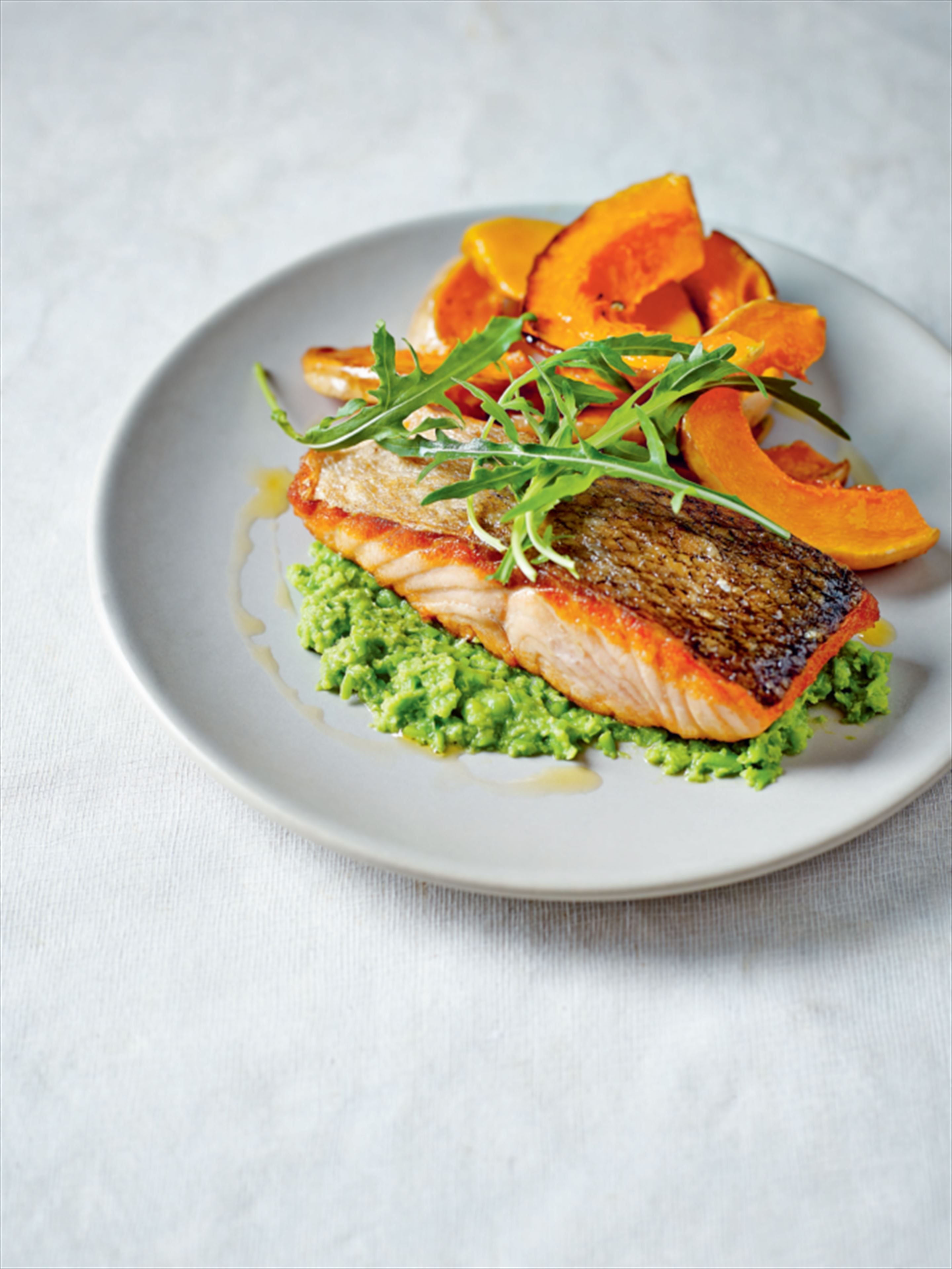 Salmon with pea purée and roasted butternut squash