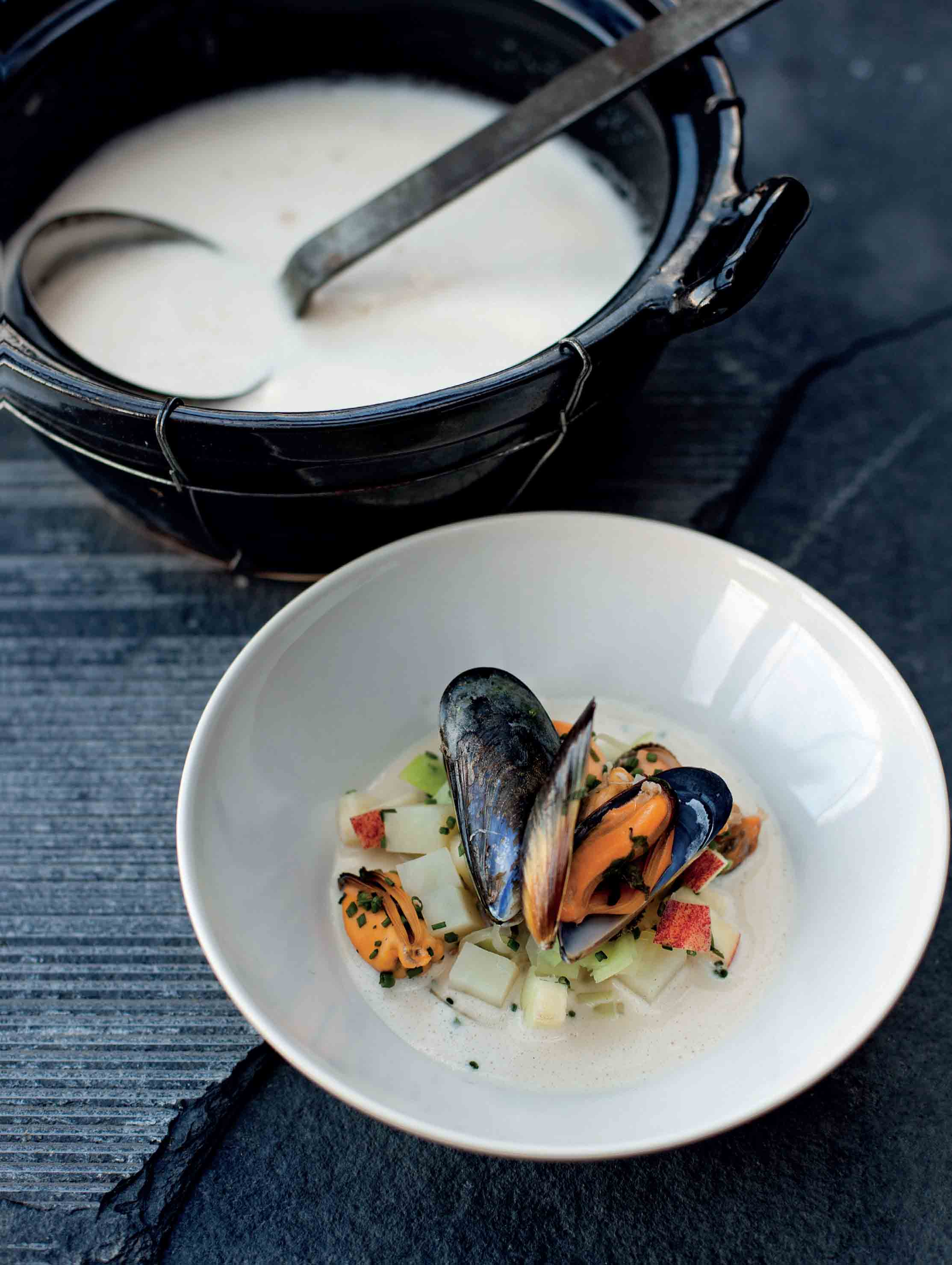 Mussels in a creamy cider broth with leek, potato and apple