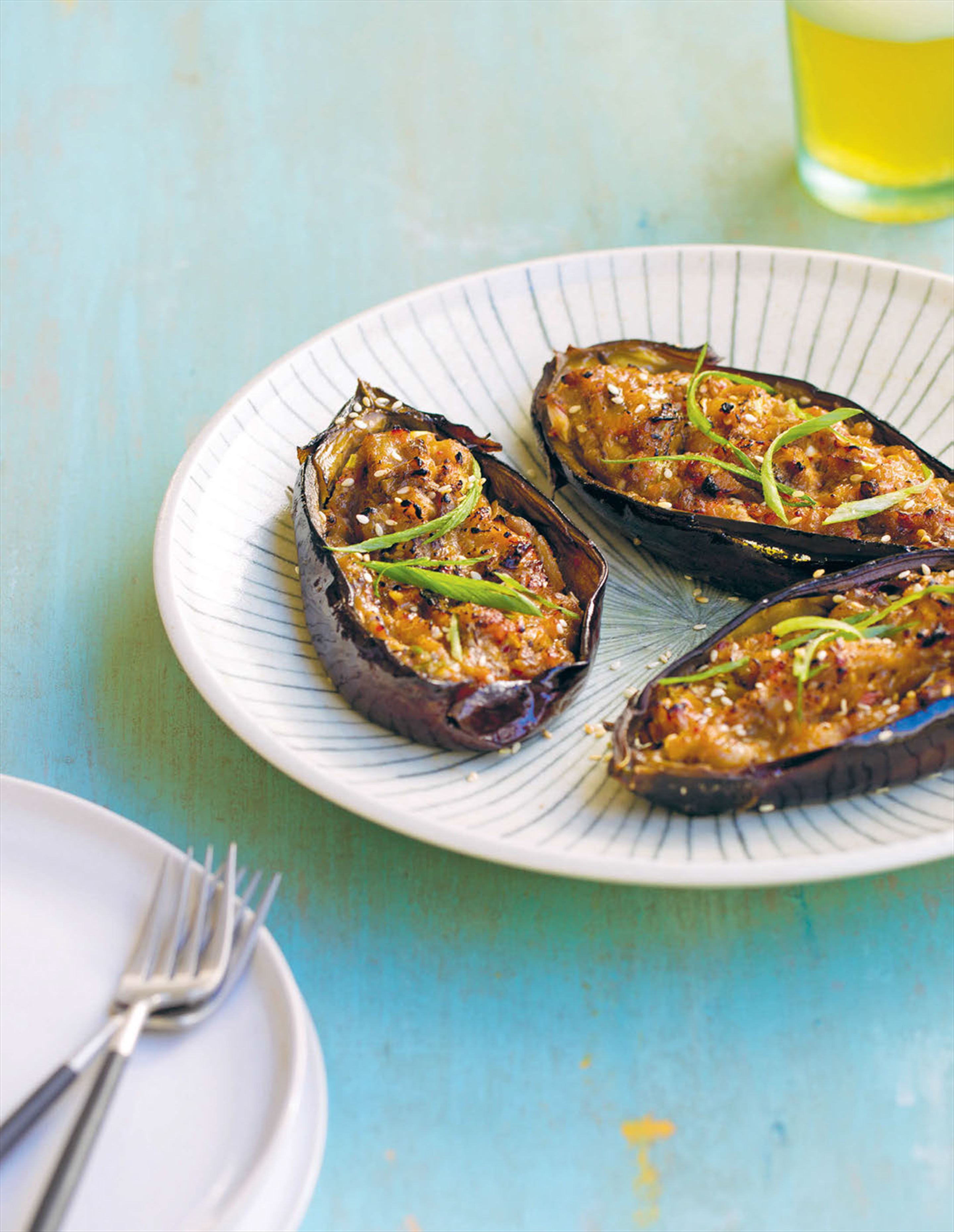 Miso-glazed eggplant with pickled ginger and spring onion