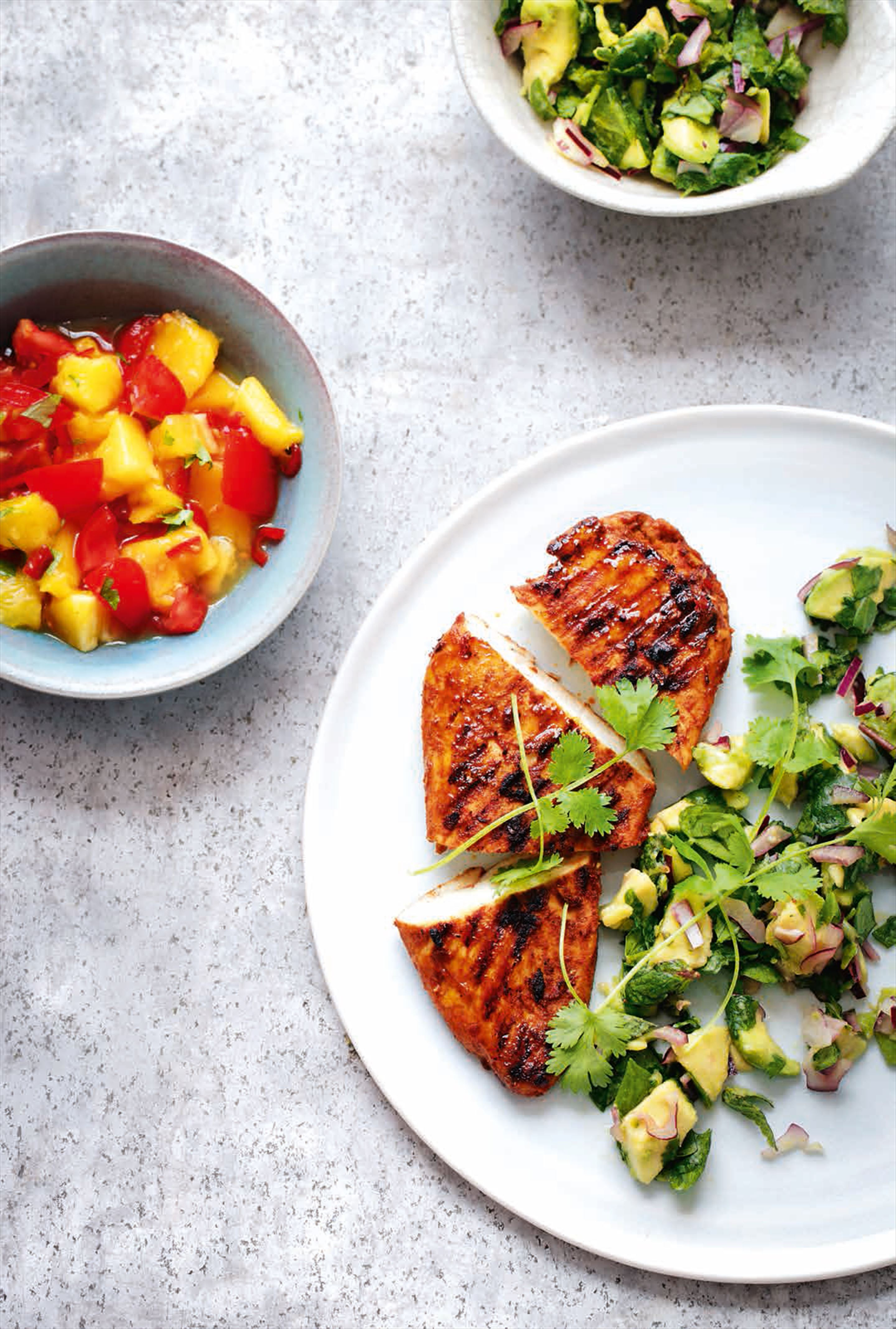 Cajun chicken with avocado salad & mango salsa
