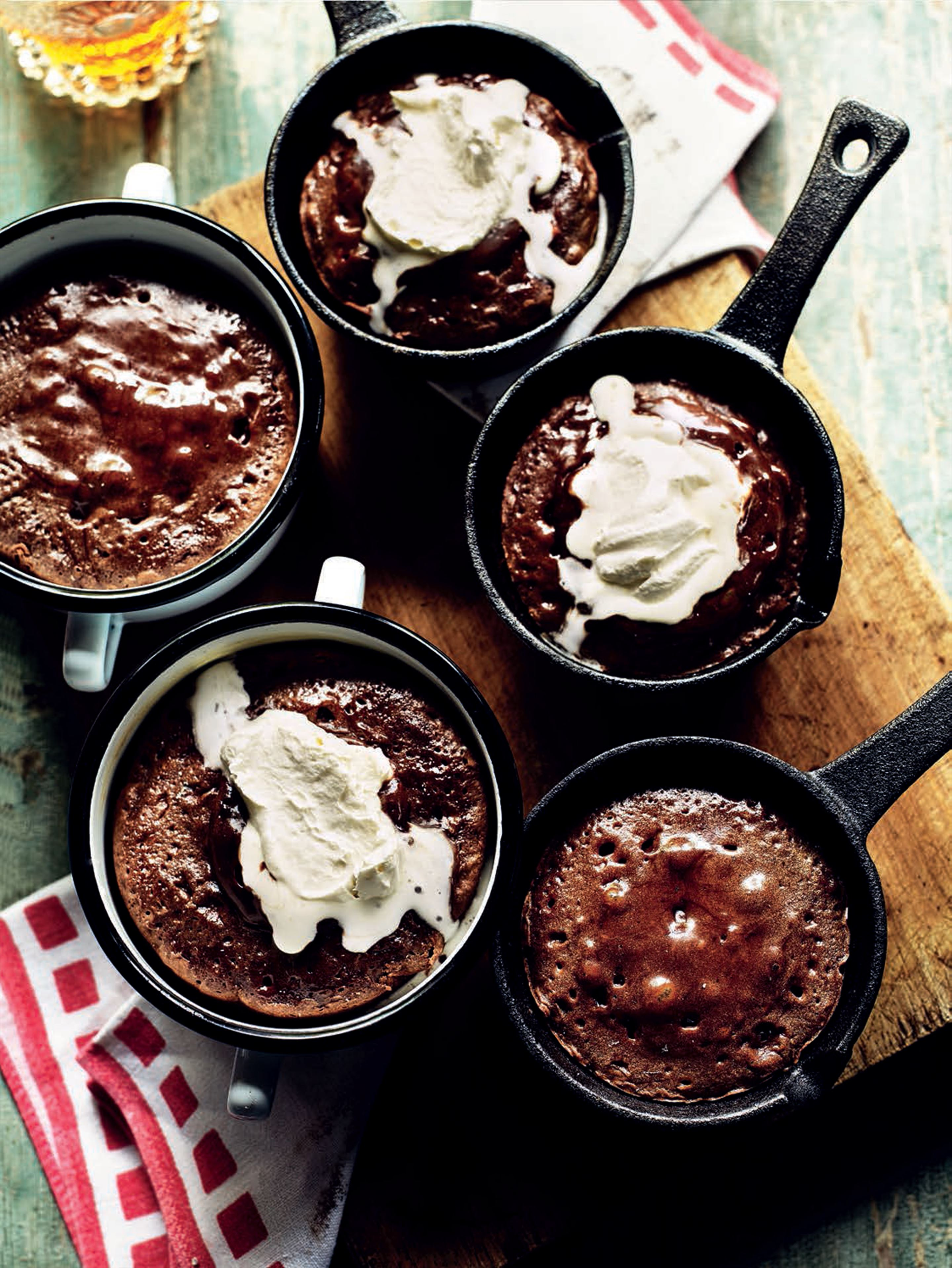 Smoky bitter-chocolate puddings with melting whipped cream
