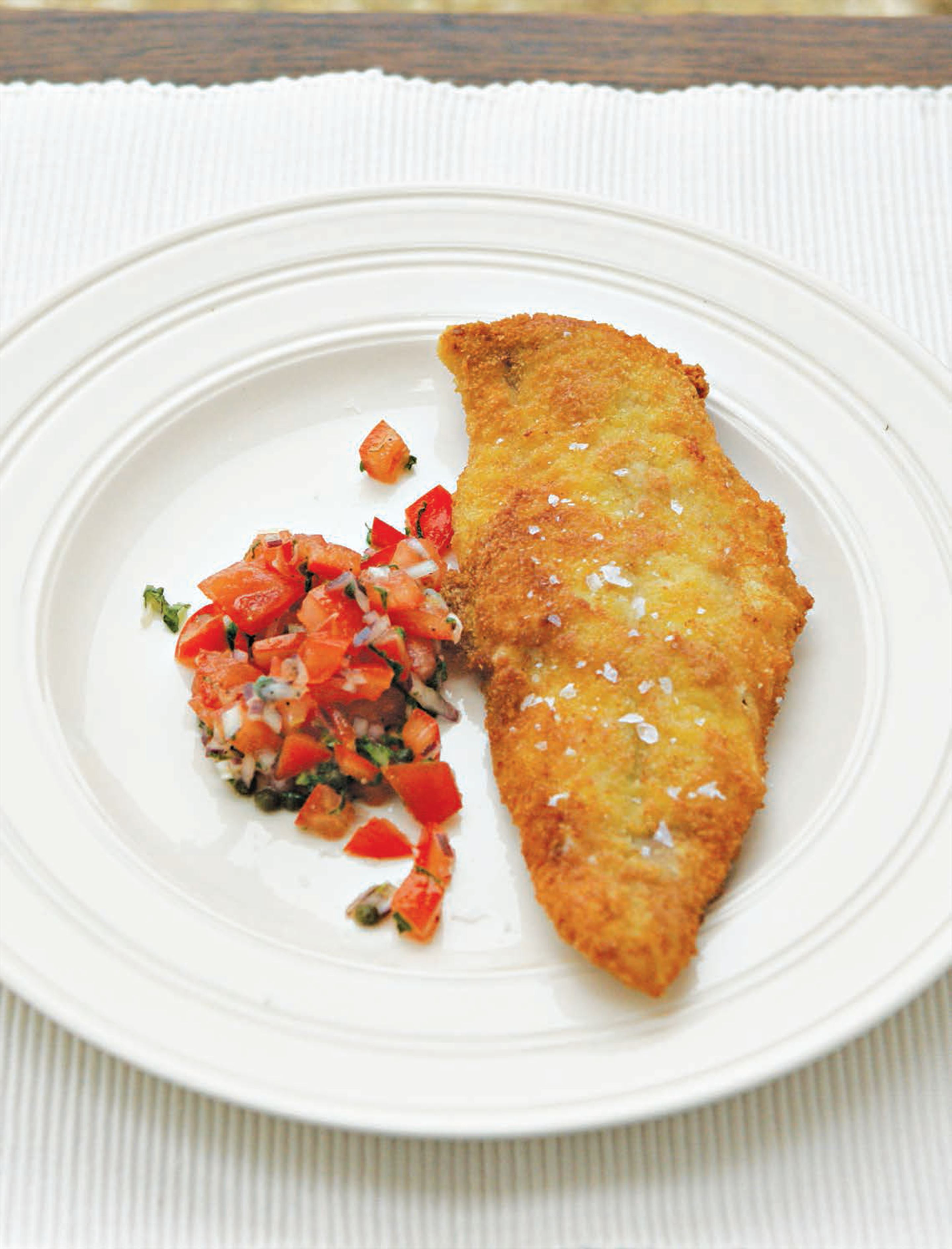 Breaded fish fillets with tomato salsa