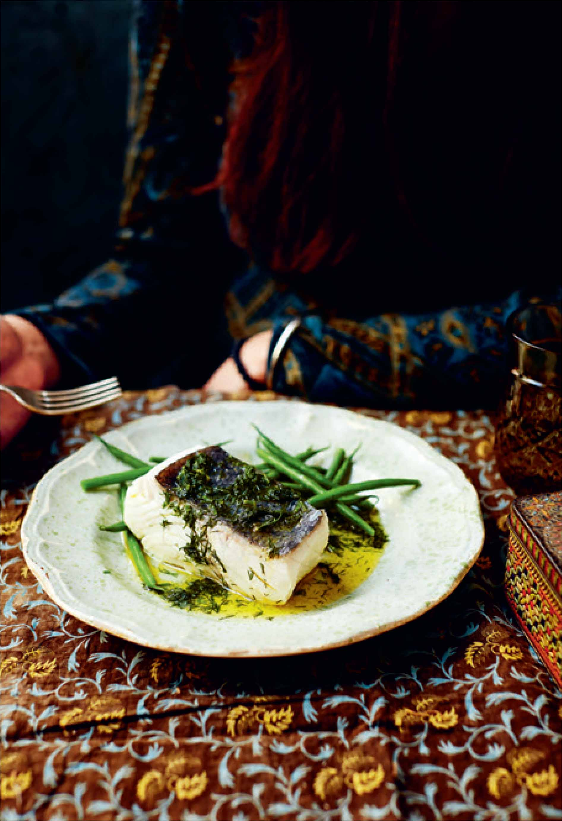 Poached halibut in buttery dill sauce