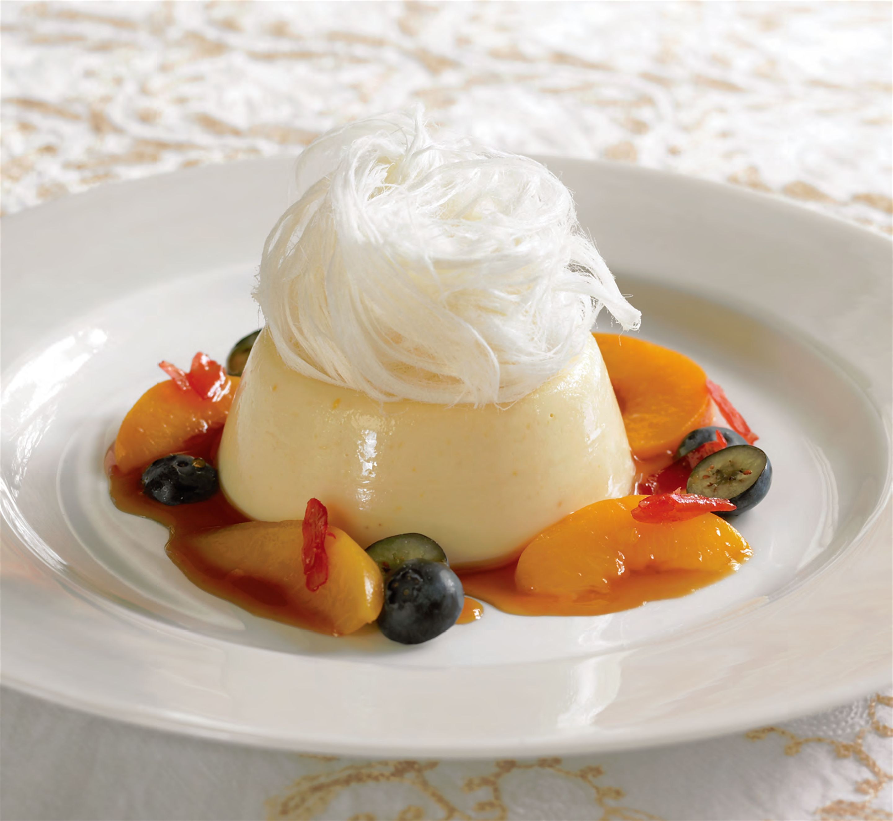 Alison's peach–yoghurt panna cotta with orange blossom–peach caramel