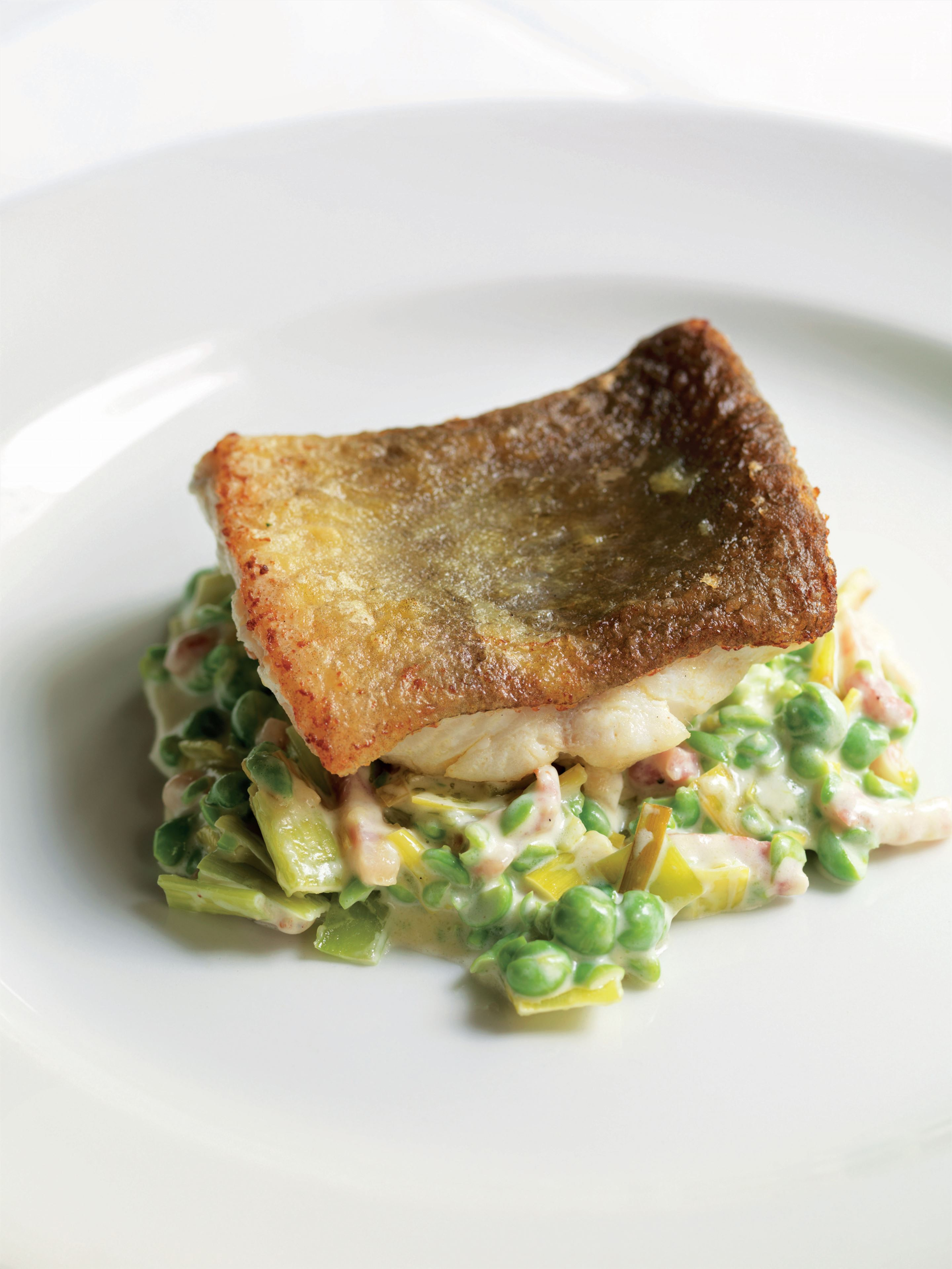 Ling with creamed peas, leeks and bacon