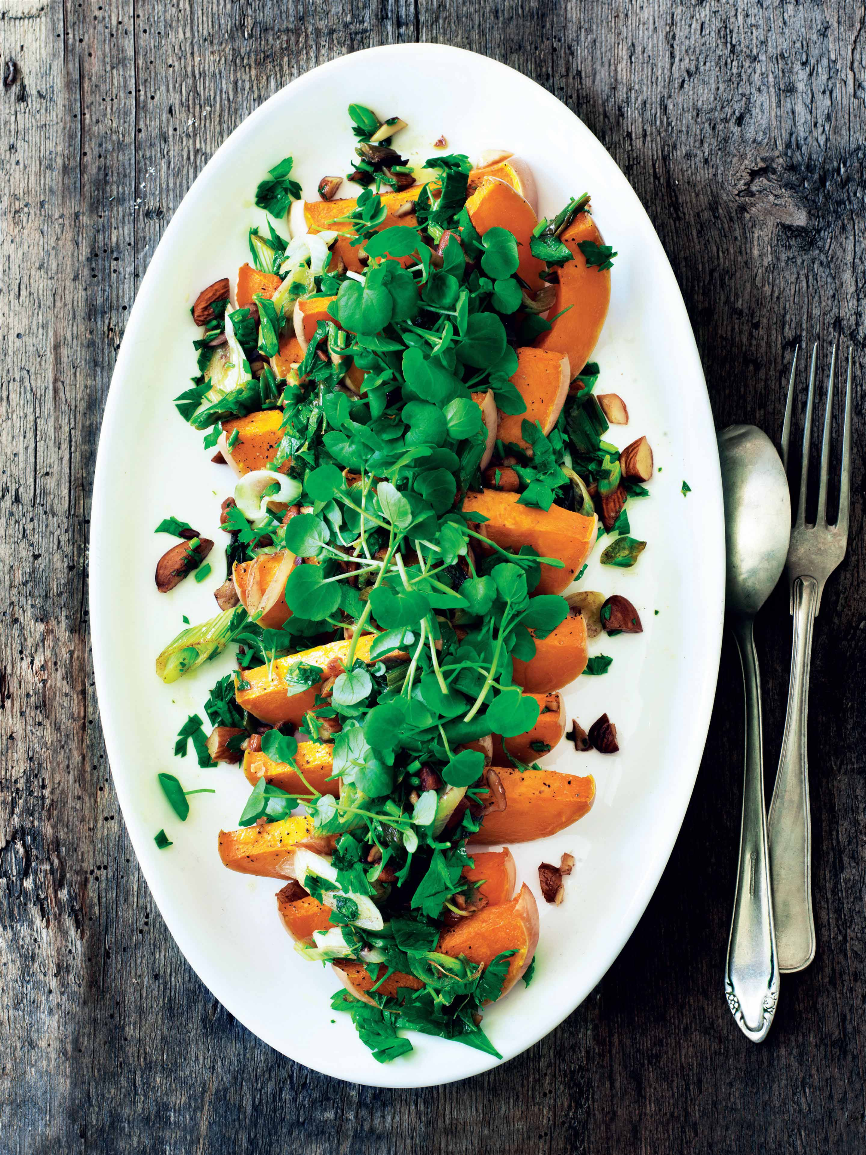 Warm butternut squash with almonds and herbs