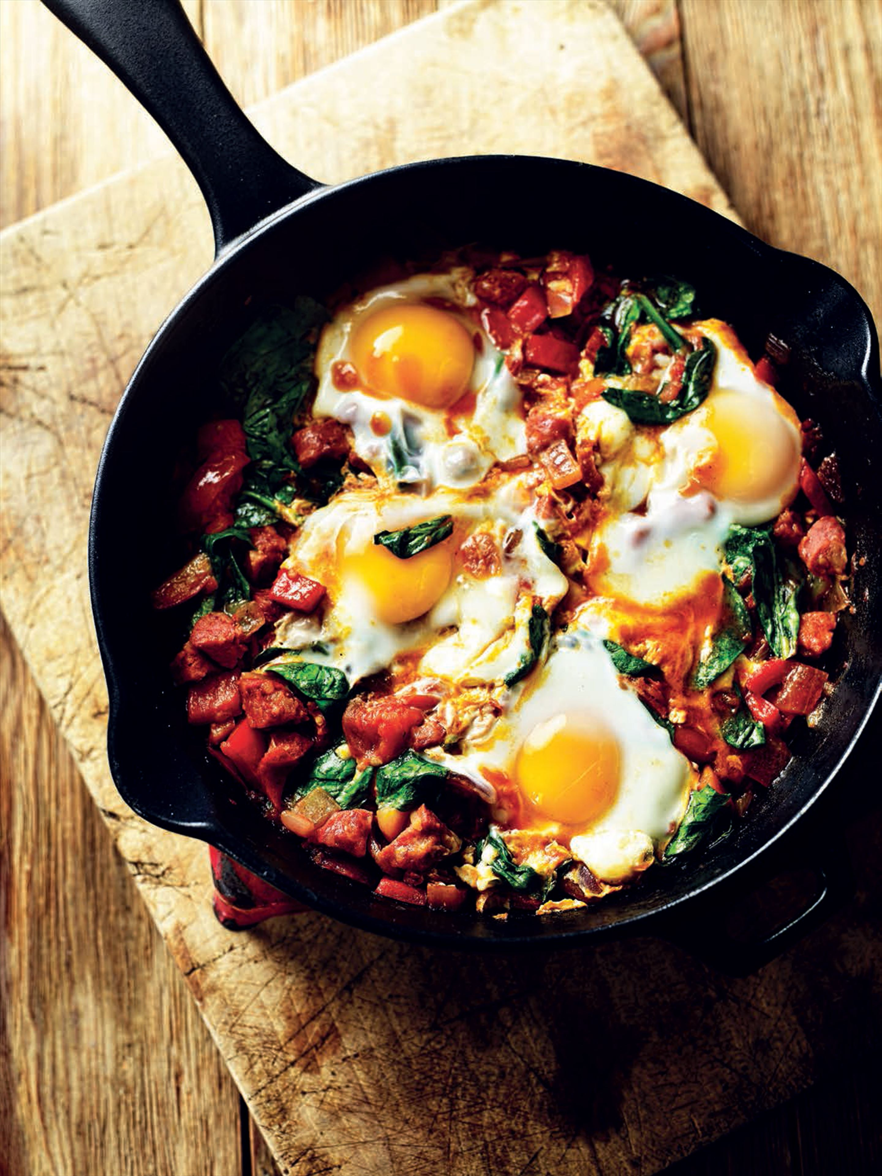 Baked eggs with chorizo, tomato, peppers and spinach