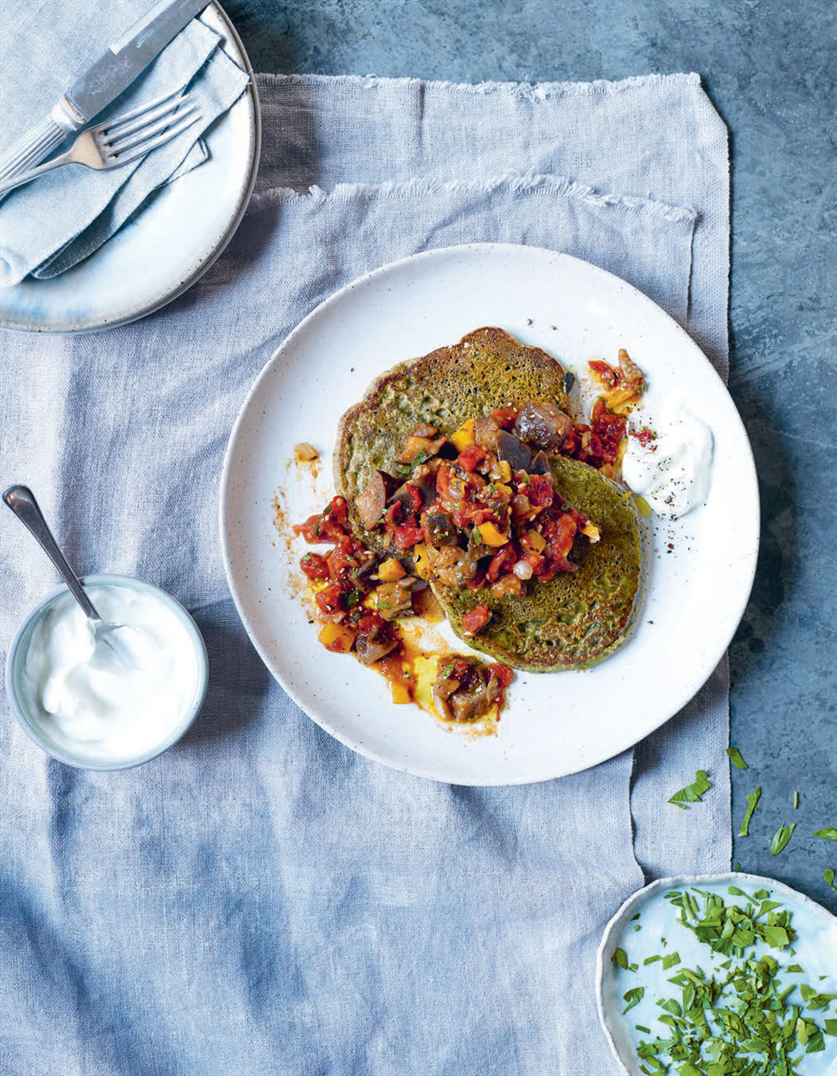 Chickpea and chard pancakes with aubergine stew