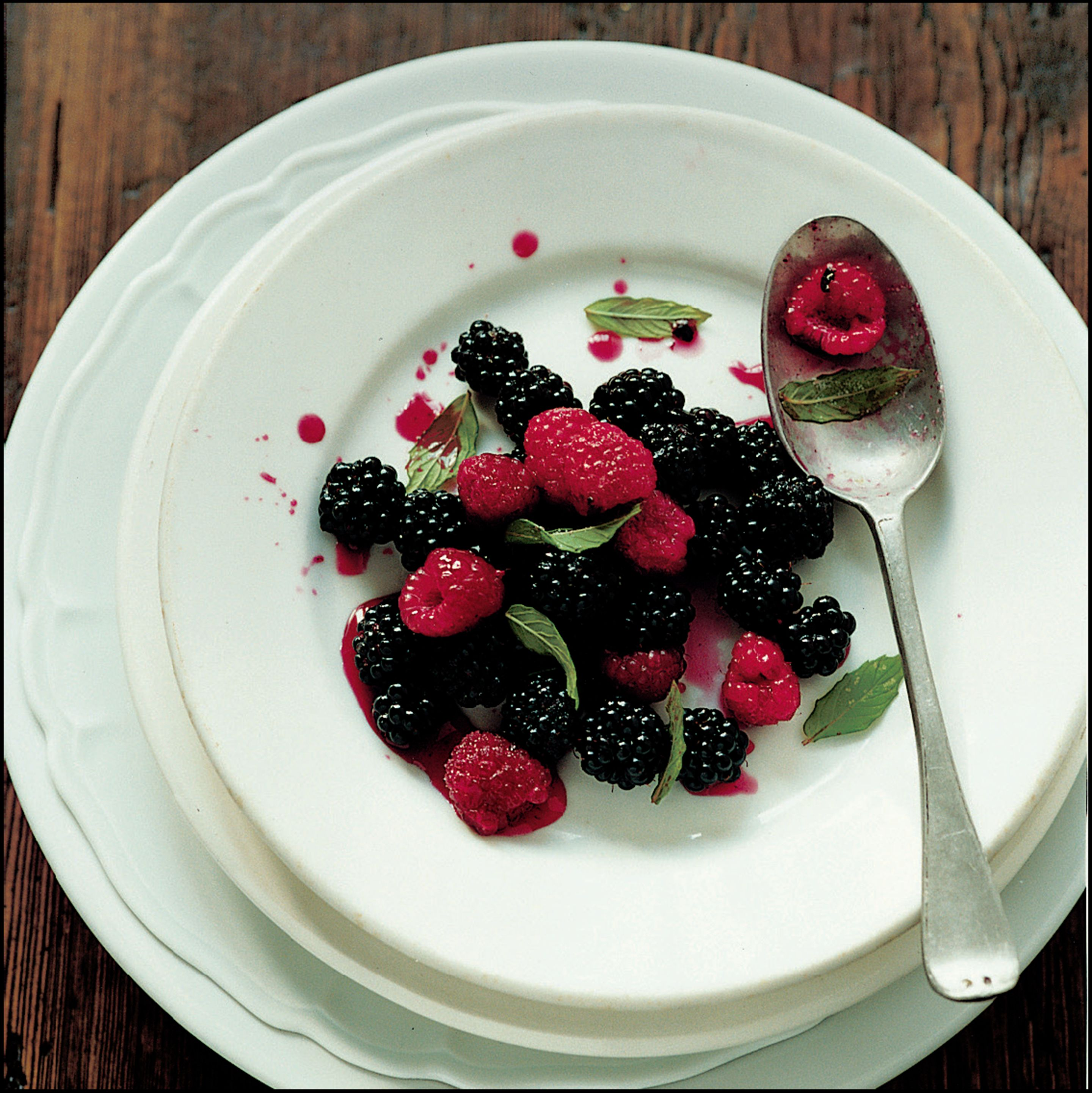 Raspberries and blackberries with sugar and lemon