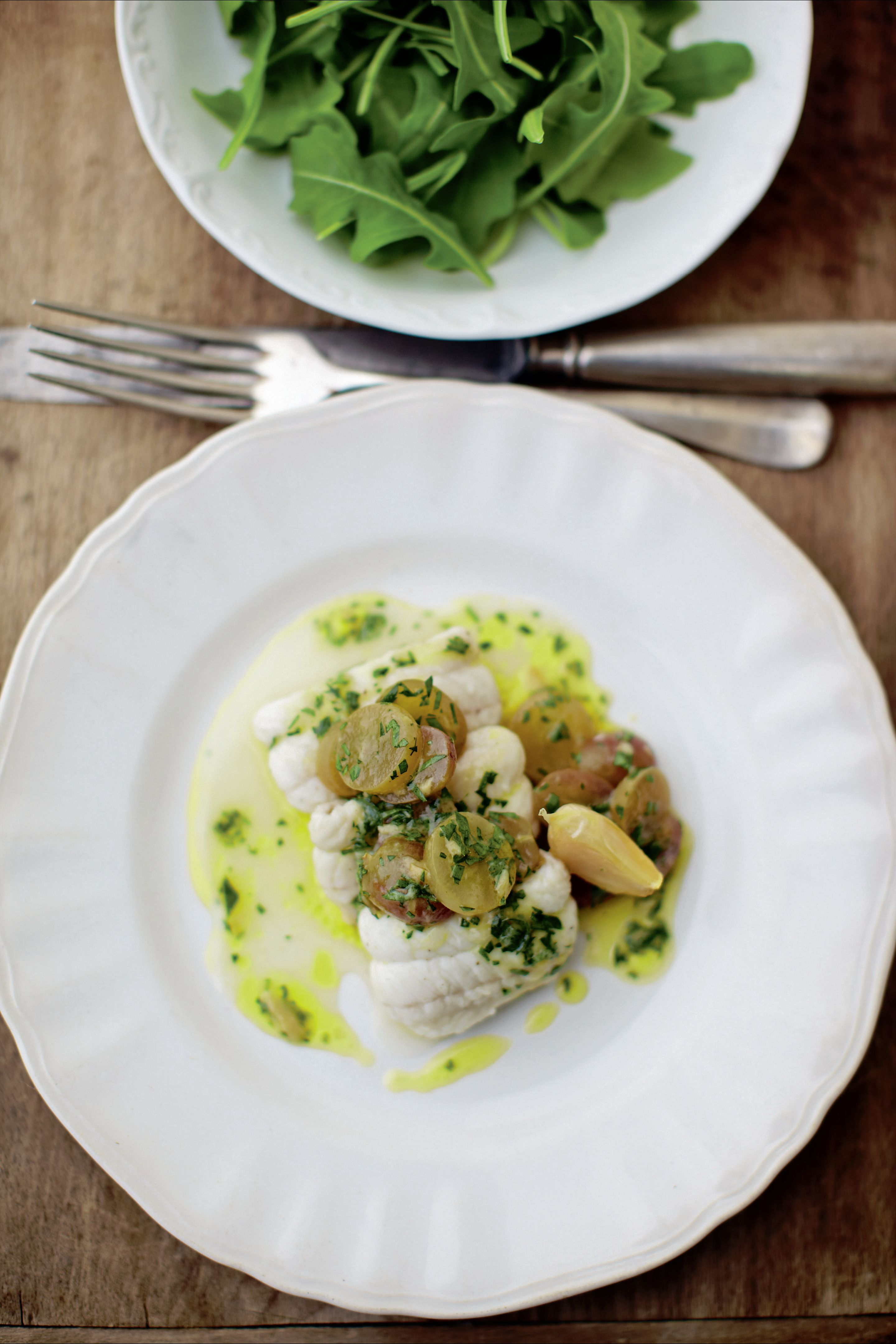 Steamed dover sole with pickled grape, roast garlic and parsley dressing