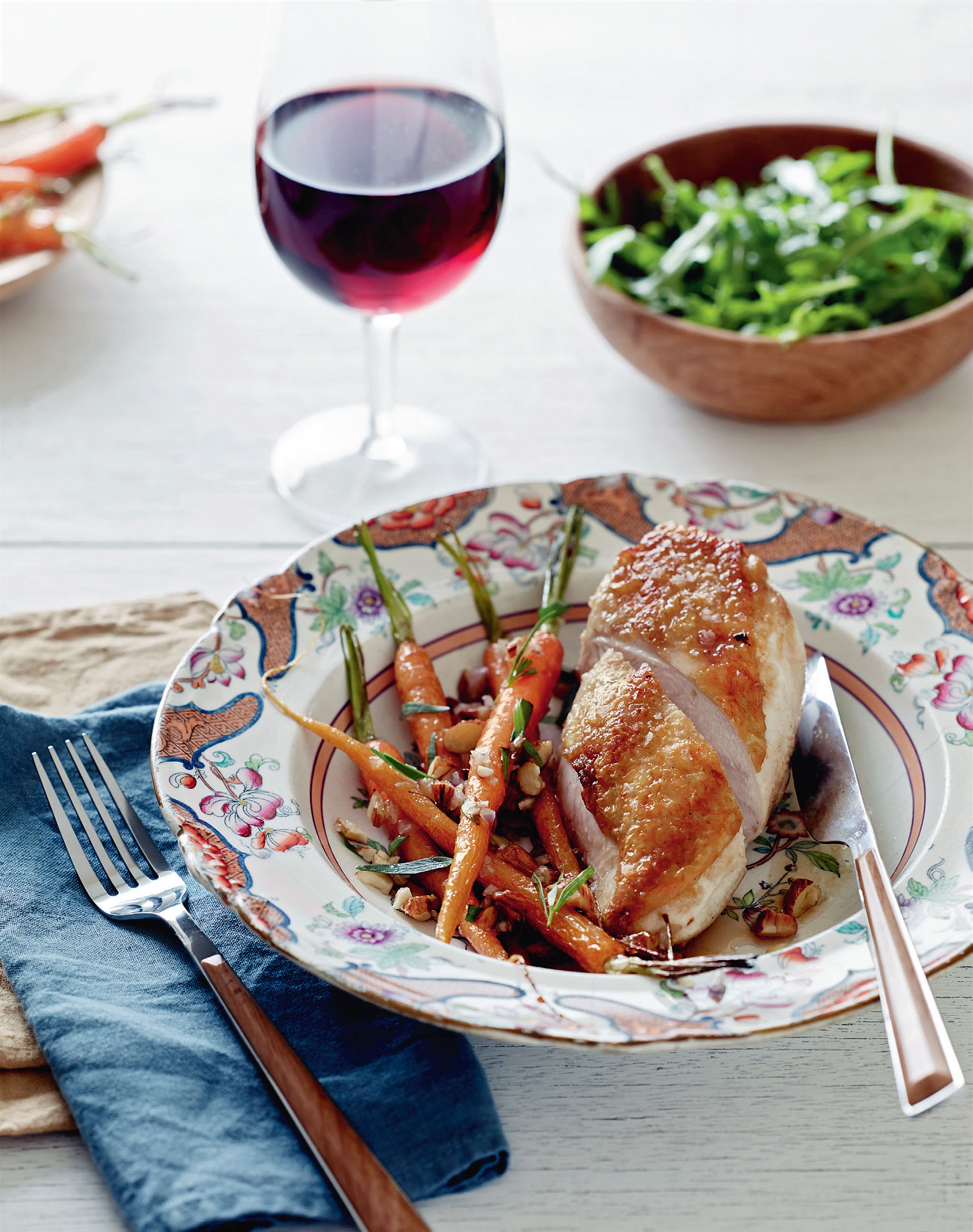 Roasted chicken with carrots and almonds