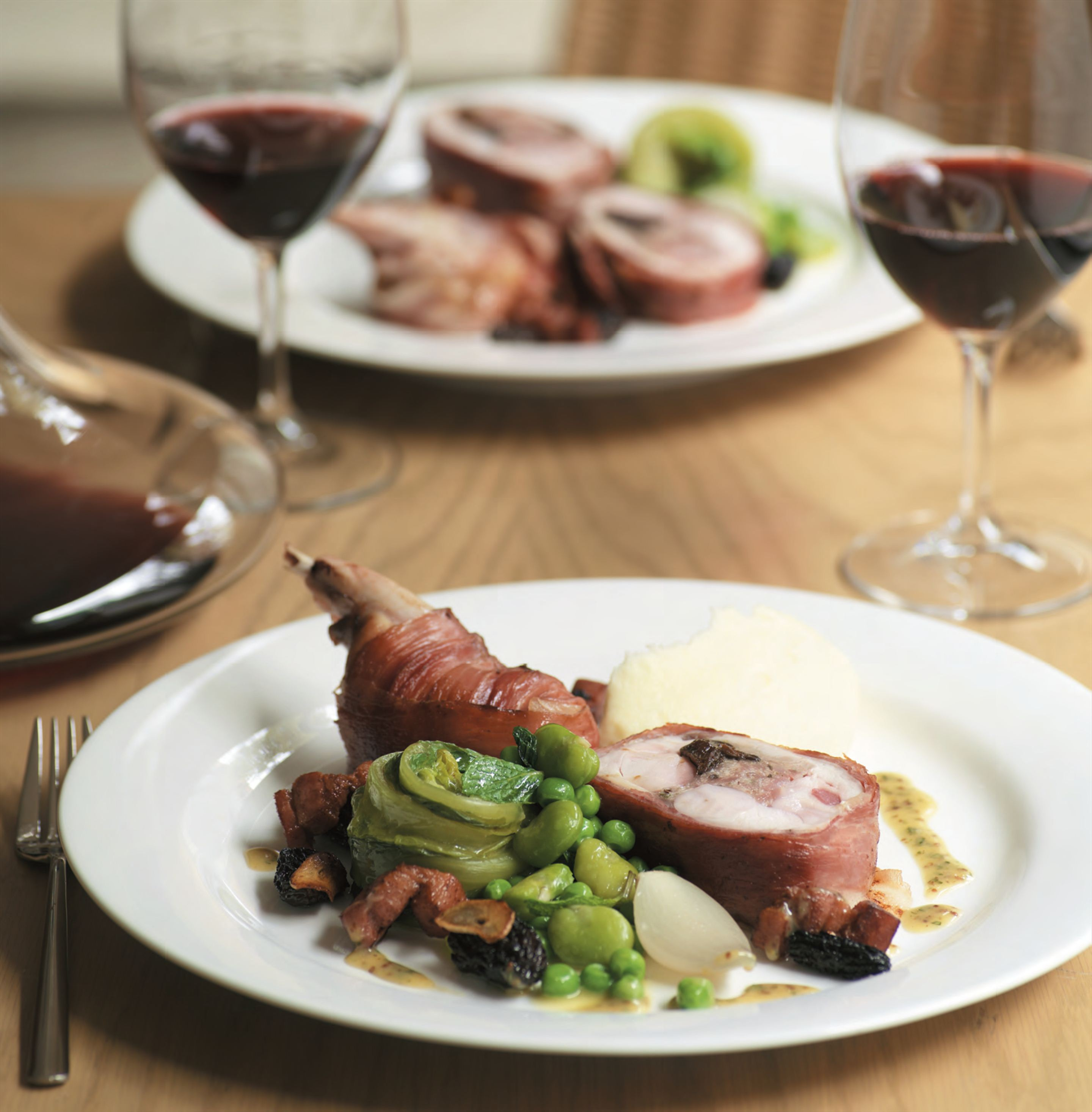 Stuffed rabbit with armagnac-soaked prunes, braised lettuce, peas and morels